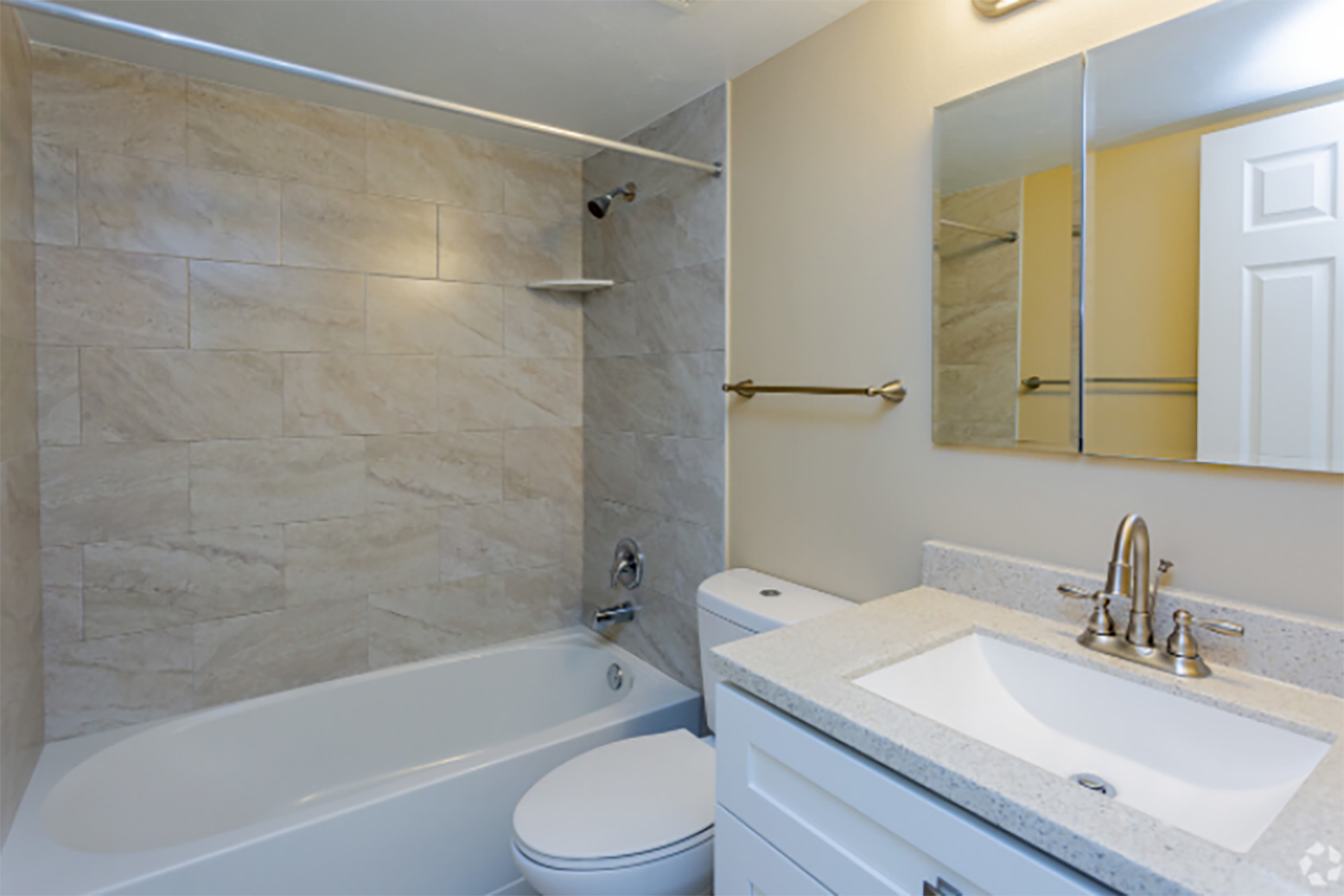 Brushed nickel bath fixtures in select homes